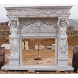 white marble fireplace with beautiful carving